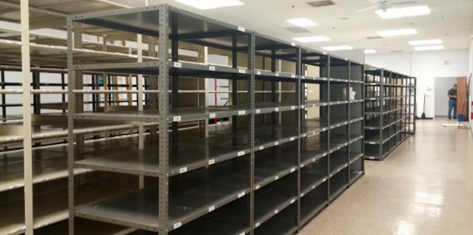 Storage shelves stand empty in a staging area at MacDill Air Force Base, Fla., Oct. 3, 2016. The wing records managers digitized their 1,700 square foot staging area over the past two years, freeing up the necessary storage to house future accountability of equipment received. (Courtesy Photo)