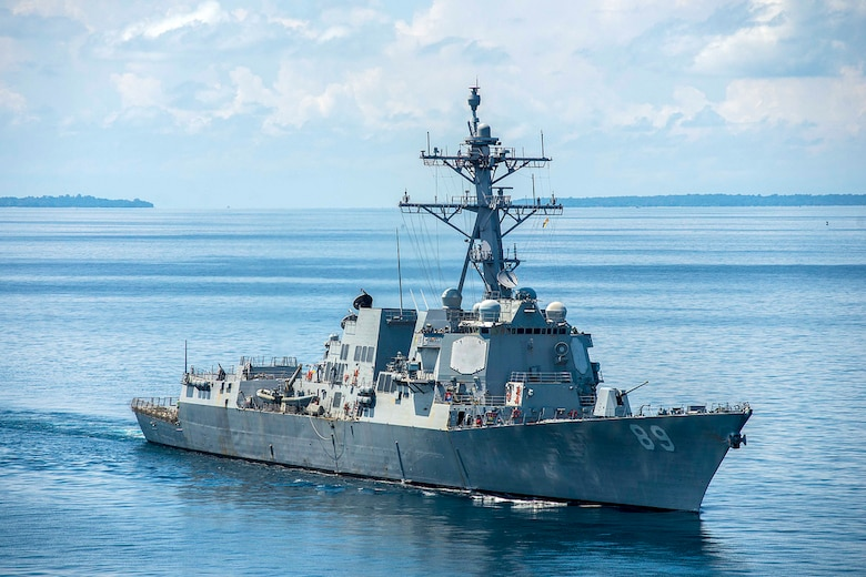 In this file photo, The Arleigh Burke-class guided-missile destroyer USS Mustin (DDG 89) steams during the Cooperation Afloat Readiness and Training (CARAT) Cambodia 2014 exercise. In its 20th year, CARAT is a series of bilateral naval exercises between the U.S. Navy, U.S. Marine Corps and the armed forces of nine partner nations in South and Southeast Asia.