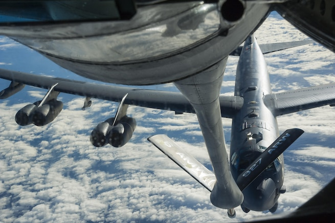 A KC-135 Stratotanker prepares to refuel a B-52 Stratofortress in midair over the United States Oct. 30, 2016, as part of Exercise Global Thunder. Once considered innovative, aerial refueling has now become a standard practice for global operations. Air Force Global Strike Command continues a legacy of innovation established by its pioneering predecessor: Strategic Air Command. (U.S. Air Force photo/Tech. Sgt. Travis Edwards)