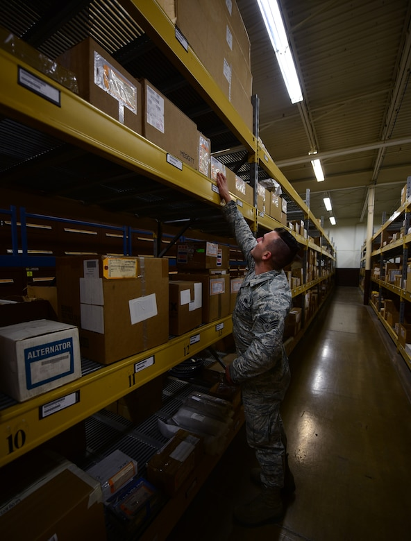 Senior Airman Bradley Weaver, a central storage technician assigned to the 28th Logistics Readiness Squadron, looks for a part at Ellsworth Air Force Base S.D., Dec. 6, 2016. Weaver and other Central Storage technicians maintain more than 18,000 assets worth more than $80 million. (U.S. Air Force photo by Airman 1st Class James L. Miller)