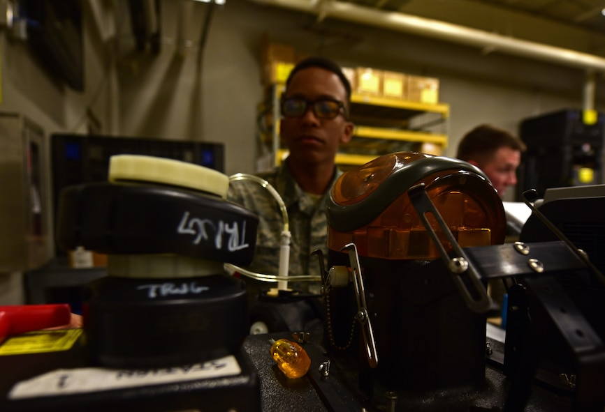Airman 1st Class Justin Stoney, an Individual Protective Equipment technician assigned to the 28th Logistics Readiness Squadron, tests the seal of a gas mask at Ellsworth Air Force Base S.D., Dec. 6, 2016. Stoney is responsible for maintaining gas masks, which includes sanitizing them when they are turned in, testing them before they are issued and inspecting them periodically to ensure their readiness. (U.S. Air Force photo by Airman 1st Class James L. Miller)
