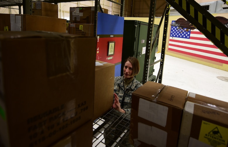Airman 1st Class Rebecca Nunez, an Aircraft Parts Store technician assigned to the 28th Logistics Readiness Squadron, organizes storage shelves in the aircraft parts store at Ellsworth Air Force Base S.D., Dec. 7, 2016. The Aircraft Parts Store remains stocked and organized at all times, which results in parts requests being handled in as little as 15 minutes. (U.S. Air Force photo by Airman 1st Class James L. Miller)