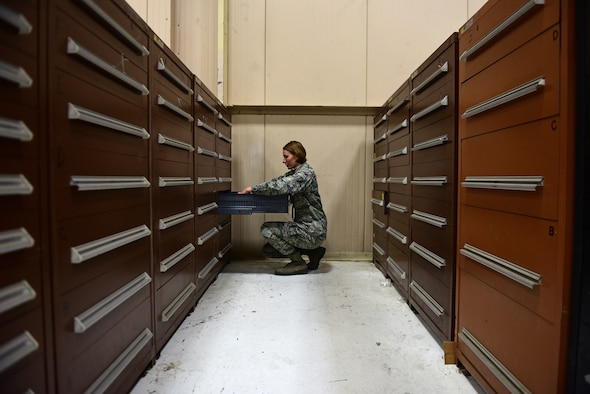 Airman 1st Class Rebecca Nunez, an Aircraft Parts Store technician assigned to the 28th Logistics Readiness Squadron, organizes a cabinet of aircraft parts in the aircraft parts store at Ellsworth Air Force Base S.D., Dec. 7, 2016. The aircraft parts store has more than 35,000 assets to ensure maintenance can get the right part as quickly as possible. (U.S. Air Force photo by Airman 1st Class James L. Miller)