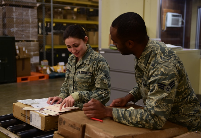 Airman 1st Class Alyssa Dreksler receives mentoring on packaging receipts from Senior Airman Jordan Fishburne, Flight Service Center technicians assigned to the a 28th Logistics Readiness Squadron, at Ellsworth Air Force Base, S.D., Dec. 6, 2016. Flight Service Center Airmen ensure all parts received are logged correctly to prevent any delays in repairs. (U.S. Air Force photo by Airman 1st Class James L. Miller)