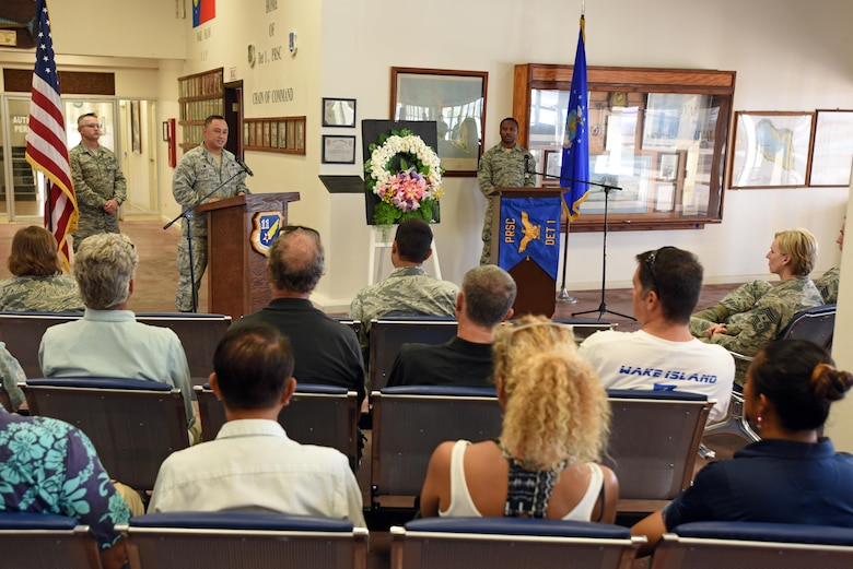 "WAKE ISLAND ATOLL-- U.S. Air Force Col. Frank Flores, Pacific Air Forces Regional Support Center commander, speaks to attendees during the Battle of Wake Island 75th anniversary ceremony. The Battle of Wake Island occured just a few hours after the attack on Pearl Harbor, Hawaii, on Dec. 7, 1941. ""We honor those brave souls who were lost and those who suffered tremendously,"" Flores said. ""We carry on the tradition of service, dedication and courage through our actions on this island today."" (U.S. Air Force photo/Tech. Sgt. John Gordinier)"
