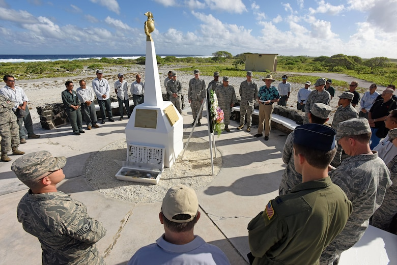 WAKE ISLAND ATOLL-- Battle of Wake Island 75th anniversary ceremony attendees, including leadership from Pacific Air Forces Regional Support Center and 11th Air Force, pay thier respects with a wreath laying and moment of silence at the Marines memorial. The Battle of Wake Island occured just a few hours after the attack on Pearl Harbor, Hawaii, on Dec. 7, 1941. (U.S. Air Force photo/Tech. Sgt. John Gordinier)