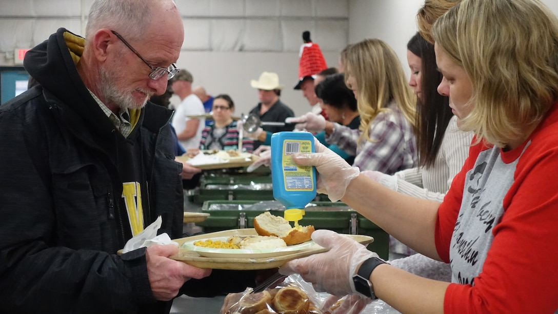 Airmen from the 139th Airlift Wing volunteer their time to prepare and serve lunch to special needs employees at Specialty Industries in St. Joseph, Mo., Dec. 15, 2016. (U.S. Air National Guard photo by Airman Audrey Chappell)