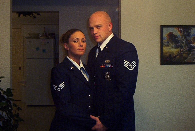 U.S. Air Force Senior Master Sgt. Joey Meininger, then a staff sergeant, now the 354th Civil Engineer Squadron deputy fire chief, poses with his wife, Audrey, in a photo from 2004. Audrey has since separated from the military to raise their three sons, but having served as a firefighter as well, she provides a great support system for Meininger. (Courtesy photo)