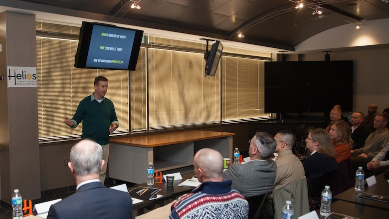 Master Sgt. Conor Mahoney, a team member of the Marine Corps Intelligence, Surveillance, and Reconnaissance Enterprise Accelerator Program, showcases new technology developed during the program at Stafford, Virginia, Dec. 9. Helios, the technology developed during the program, is designed to keep request for intelligence (RFI) customers informed throughout the production process. The demonstration is the culmination of 12 weeks of design and development for Helios.