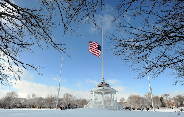 The flag was at half-staff on the Offutt AFB parade ground as the snow began to fall in December 2012. Don't get caught unprepared for the frigid weather this winter, take precautions to ensure success if you ever get caught out in the cold. (U.S. Air Force photo by Josh Plueger)