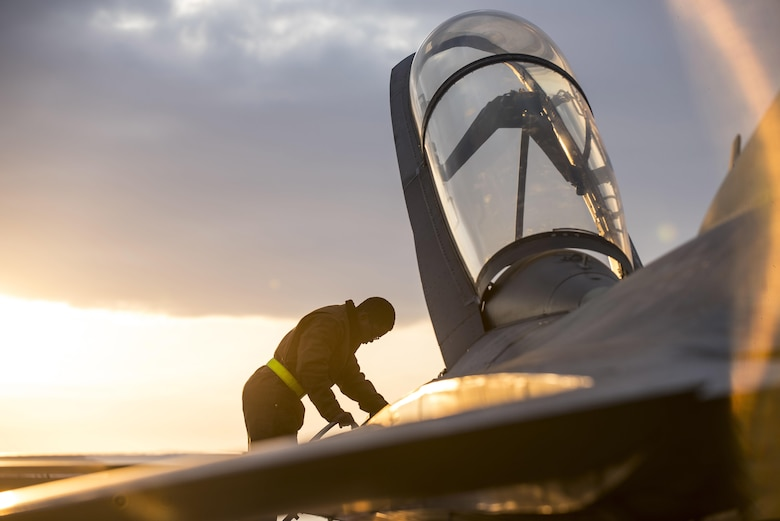 U.S. Air Force Airman Hoyal Moseley, a 14th Aircraft Maintenance Unit crew chief, climbs down a ladder at Misawa Air Base, Japan, Dec. 12, 2016. Crew chiefs perform inspections for the F-16 Fighting Falcon before every flight ensuring pilots are operating a reliable, mission capable aircraft. Inspections include reviewing hydraulic and oil levels as well as general airframe damage. (U.S. Air Force photo by Airman 1st Class Sadie Colbert)