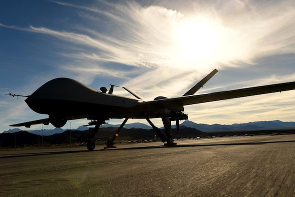 An MQ-9 Reaper sits on the flight line Nov. 22, 2016, at Creech Air Force Base, Nev. The Reaper is an evolution of the MQ-1 Predator and can carry four AGM-114 Hellfire missiles and two 500 pound bombs while being able to fly for 18-24 hour missions. (U.S. Air Force photo by Senior Airman Christian Clausen)