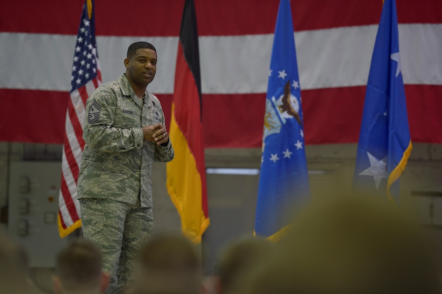 Chief Master Sgt. Phillip Easton, 3rd Air Force and 17th Expeditionary Air Force command chief, talks about the importance of family during an all call at Hangar One on Spangdahlem Air Base, Germany, Dec. 14, 2016. During the 3rd AF leadership visit they were given a tour around base and met with Airmen. (U.S. Air Force photo by Staff Sgt. Jonathan Snyder)