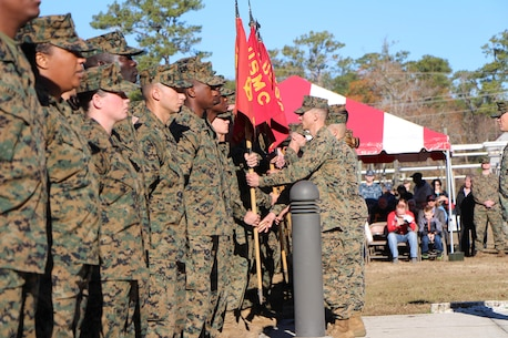 After 8 weeks of intense mental and physical training, the platoon leadership of Class 17010 returns the platoon guidons to their instructors at the FMTB-E graduation ceremony.