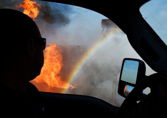 A firefighter uses a rapid intervention vehicle to respond to an aircraft fire during training Dec. 7, 2016, at Luke Air Force Base, Ariz. This training was performed by firefighters from the 56th Civil Engineer Squadron and the Gila Bend Fire Department. (U.S. Air Force photo/Senior Airman James Hensley)
