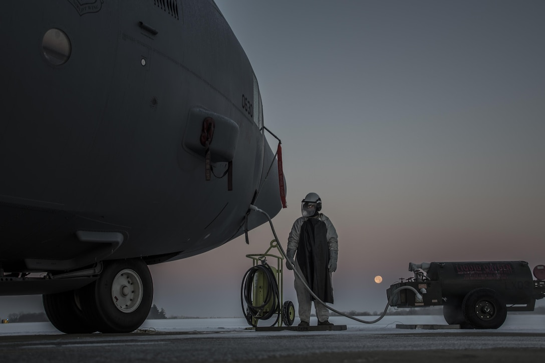 Tech. Sgt. Jordan Brown refills a C-130H Hercules with liquid oxygen on the flightline of the 179th Airlift Wing in Mansfield, Ohio, Dec. 14, 2016. The 179th AW is always on a mission to be the first choice to respond to state and federal missions. (U.S. Air National Guard photo/Tech. Sgt. Joe Harwood)