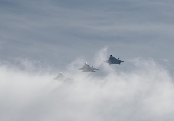 Three F-22 Raptors from Tyndall Air Force Base, Fla., fly in formation during Checkered Flag 17-1 on Dec. 8, 2016. The integration training pilots receive during exercises like Checkered Flag ensure they can seamlessly work together in a real-world combat situation. (U.S. Air Force photo/Staff Sgt. Alex Fox Echols III)