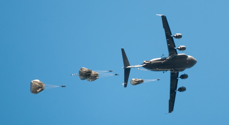 U.S. and foreign paratroopers jump from a C-17 during Operation Toy Drop XIX Dec., 10 at Luzon drop zone at Camp Mackall, N.C.  During OTD U.S. paratroopers have the chance to train with jumpmasters from other nations, learn about their training tactics, and expand their experience through working with partner nations. (U.S. Army photo by Spc. Tynisha L. Daniel)