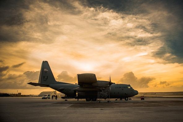 A C-130 Hercules sits on the runway during Operation Christmas Drop 2016 at Andersen Air Force Base, Guam, Dec. 6, 2016. This year marked the 65th year of OCD, which began in 1952, making it the world's longest-running airdrop mission. (U.S. Air Force photo/Senior Airman Delano Scott)