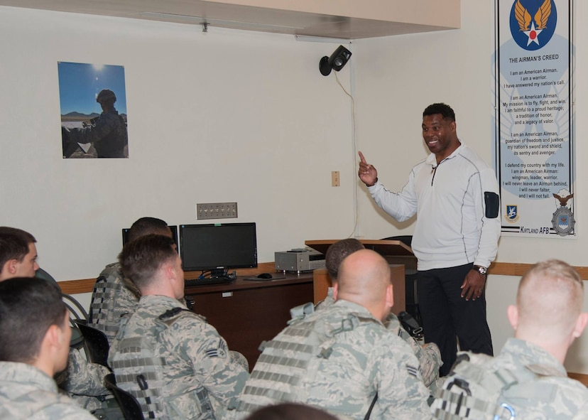 Former Heisman Trophy winner Herschel Walker speaks to Airmen of the 377th Weapons System Security Squadron during his visit to Kirtland Dec. 12-13. Walker spoke at multiple venues on base, detailing his struggles with mental illness and encouraging those with issues to seek help.