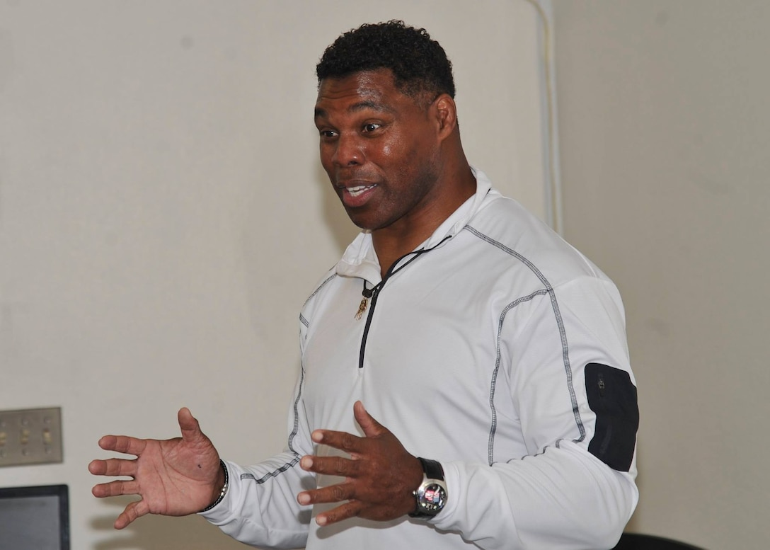 Former pro football player Herschel Walker speaks Team Kirtland members during his visit to the base Dec. 12-13. Walker came to the base to tell Airmen about his suffering with a mental illness. He said there is no shame in asking for help.