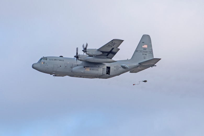 In a first for the 375th Air Mobility Wing and the next step in certifying a new Drop Zone area for use on Scott's flight line, a C-130 performs a test air drop Dec. 13, 2016, Scott Air Force Base, Ill. The 375th Operational Support Squadron created the Drop Zone to increase the readiness of units in and around Scott and for use by flying or ground units with an interest and the requirement. This new capability opens up a multitude of functions that the airfield can provide, making Scott a desired destination for aviators and jumpers. The C-130 was from the 180th Airlift Squadron, Air National Guard, St. Joseph, Mo.