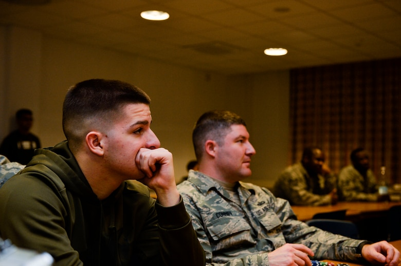 Airmen listen to a talk given by an NCO during a Huddle meeting at Ramstein Air Base, Germany, Dec. 13, 2016. The Huddle is a club which aims to provide mentorship opportunities to young Airman and encourages open dialogue between the junior enlisted and senior NCO corps. (U.S. Air Force photo by Airman 1st Class Joshua Magbanua)