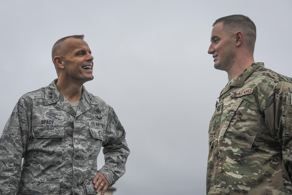 """Maj. Gen. Bradley Spacy, left, the commander of the Air Force Installation and Mission Support Center, speaks with Capt. Justin May, operations officer with the 1st Special Operations Security Forces Squadron, at Hurlburt Field, Fla., Dec. 14, 2016. Spacy observed capability demonstrations such as the 1st Special Operations Logistics Readiness Squadron conducting a Forward Air Refueling Point. Special teams of fuels Airmen provide a critical capability for wartime and humanitarian missions as FARP operations expand the role of special operation forces around the world. They provide a means of """"hot"""" refueling from a tanker aircraft to various types of fixed and rotor-wing receiver aircraft. (U.S. Air Force photo by Airman Dennis Spain)"""