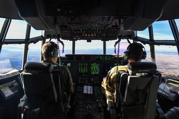 Maj. Brian Pesta, left, and Maj. Justin Eulberg, pilots with the 1st Special Operations Group, Detachment 2, fly the AC-130J Ghostrider over White Sands Missile Range, N.M., Dec. 13, 2016. The 1st SOG, Det 2, went to Cannon AFB, N.M. to continue operational testing of Laser Small Diameter Bomb drops. (U.S. Air Force photo by Senior Airman Jeff Parkinson)