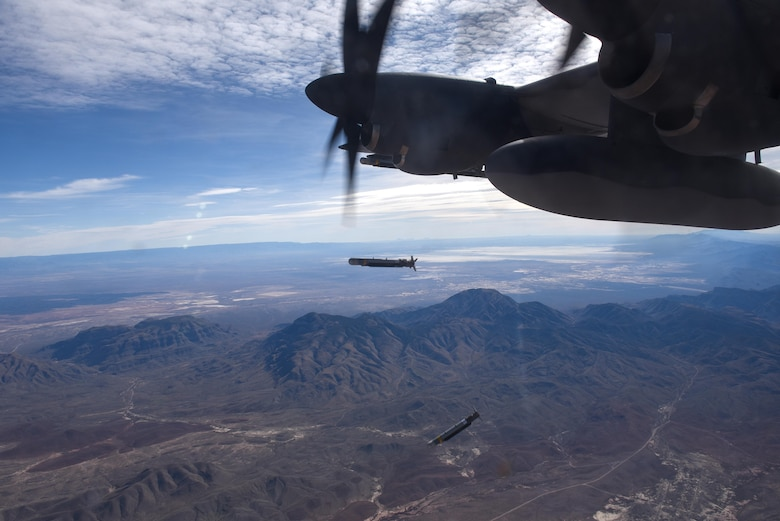 Two, Laser Guided Small Diameter Bombs are released from the wing of an AC-130J Ghostrider over White Sands Missile Range, N.M., Dec. 13, 2016. The AC-130J is outfitted with multiple weapons systems to include a 30mm and 105mm cannon, GBU-39 Small Diameter Bombs and AGM-176 Griffin missiles. (U.S. Air Force photo by Senior Airman Jeff Parkinson)