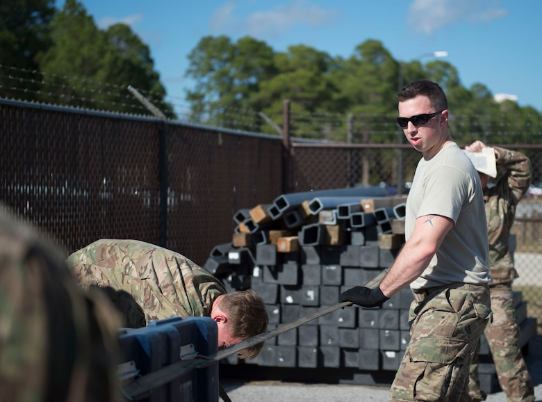Staff Sgt. Jerred Brown, an aircrew flight equipment craftsman with the 34th Special Operations Squadron, straps down cargo during pallet build-up training at Hurlburt Field, Fla., Dec. 12, 2016. AFE Air Commandos were trained how to properly document and load cargo onto aircraft, ensuring readiness to execute global special operations. (U.S. Air Force photo by Senior Airman Krystal M. Garrett)