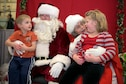 The children of U.S. Air Force Staff Sgt. Sarah Kaiser, an instrumentalist with the 566th Air Force Band, Illinois Air National Guard, visit with Santa and Mrs. Claus at the 182nd Airlift Wing's annual holiday party Dec. 3 in Peoria, Ill. The wing held the event to provide ANG families an opportunity to celebrate with their fellow unit members. (U.S. Air National Guard photo by Tech. Sgt. Lealan Buehrer)