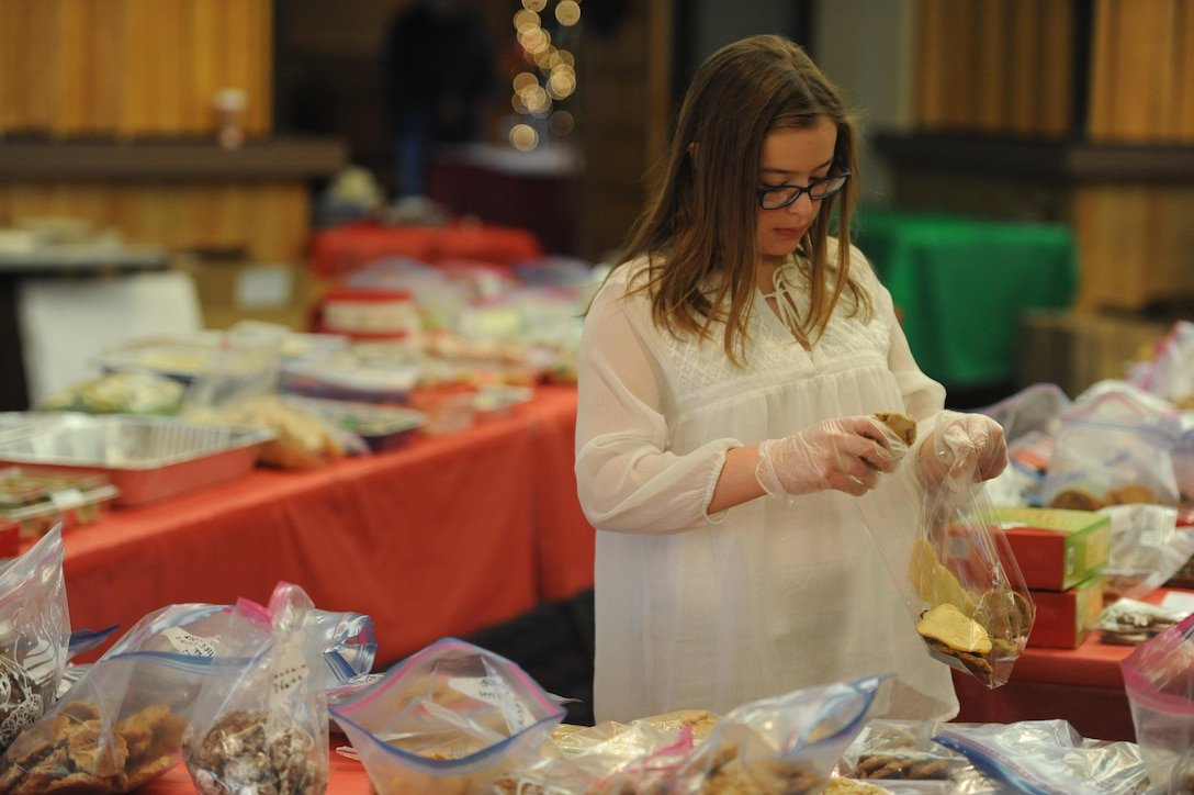 Lara Arnold, 12, puts together cookie packages to be delivered to Airmen living on base as part of the Kirtland Spouses' Club's annual cookie drive. The KSC rolled past its goal of collecting about 10,000 cookie, collecting more than 12,000 cookies from the base community.