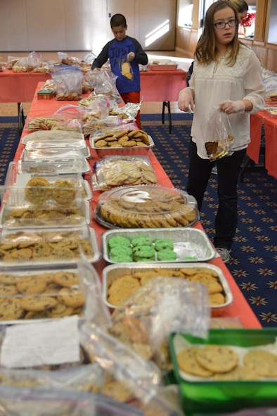 Volunteers help put together cookie packages to be delivered to Airmen living on base as part of the Kirtland Spouses' Club's annual cookie drive. The KSC rolled past its goal of collecting about 10,000 cookie, collecting more than 12,000 cookies from the base community.