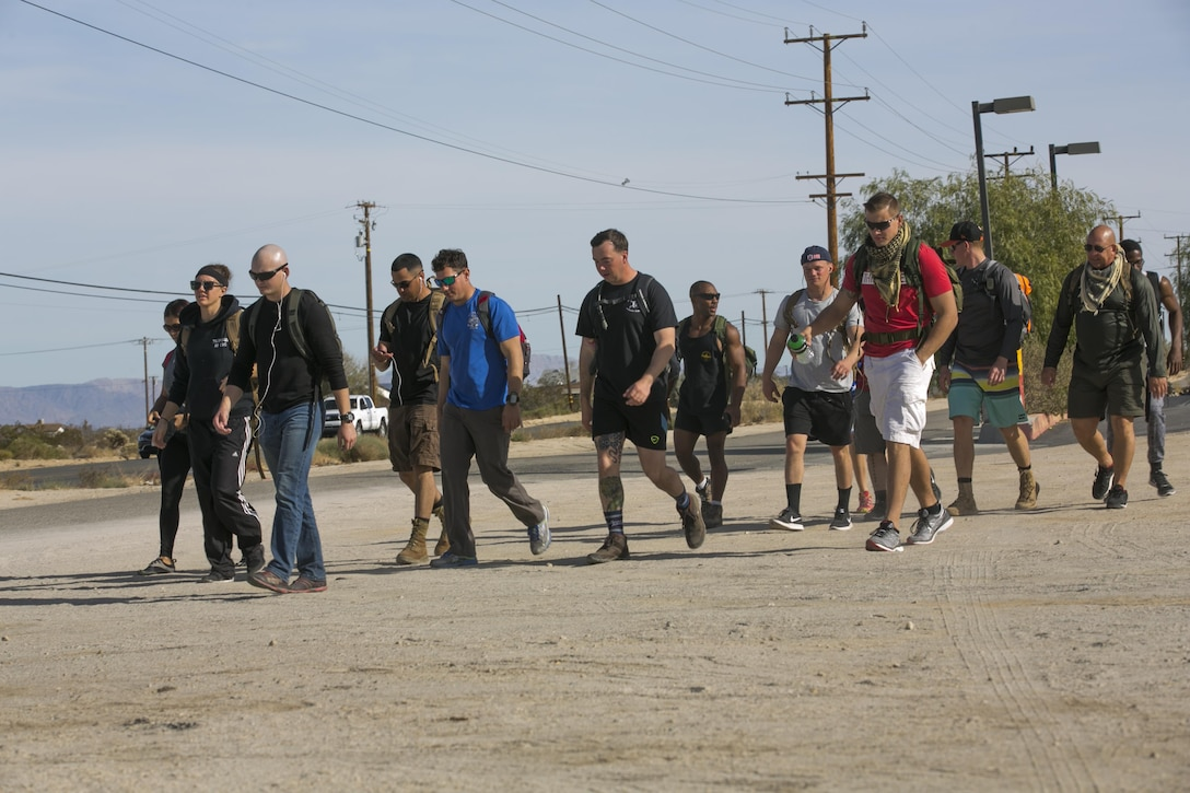 Participants of the second annual Road March for St. Jude Children's Research Hospital hike to raise money for charity in Twentynine Palms, Calif., Dec. 10, 2016. Mark Gelekto, tactical training support, 7th Marine Regiment, organized the event to raise money to donate to children in need. (Official Marine Corps photo by Cpl. Thomas Mudd/Released)