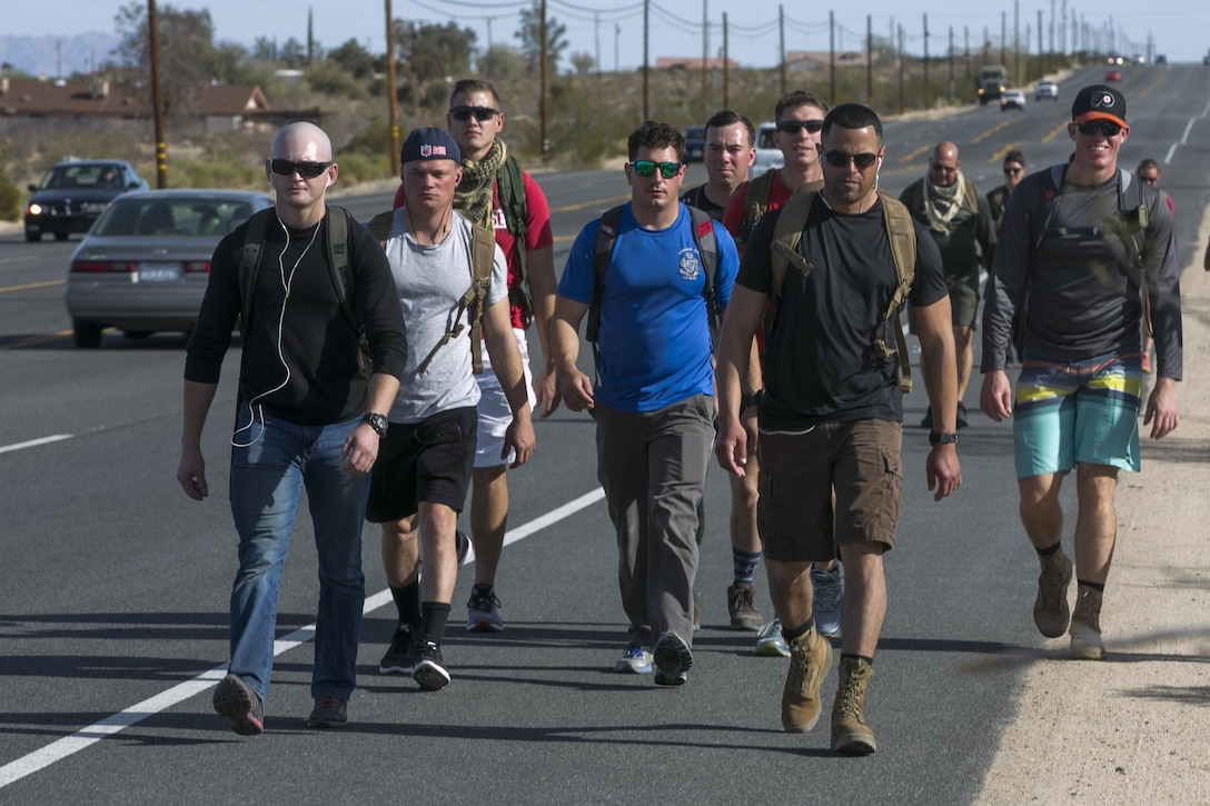 Participants of the second annual Road March for St. Jude Children's Research Hospital hike down California Highway 62 toward their end goal of Kimi Grill in Yucca Valley, Calif., Dec. 10, 2016. Mark Gelekto, tactical training support, 7th Marine Regiment, organized the event to raise money to donate to children in need. (Official Marine Corps photo by Cpl. Thomas Mudd/Released)