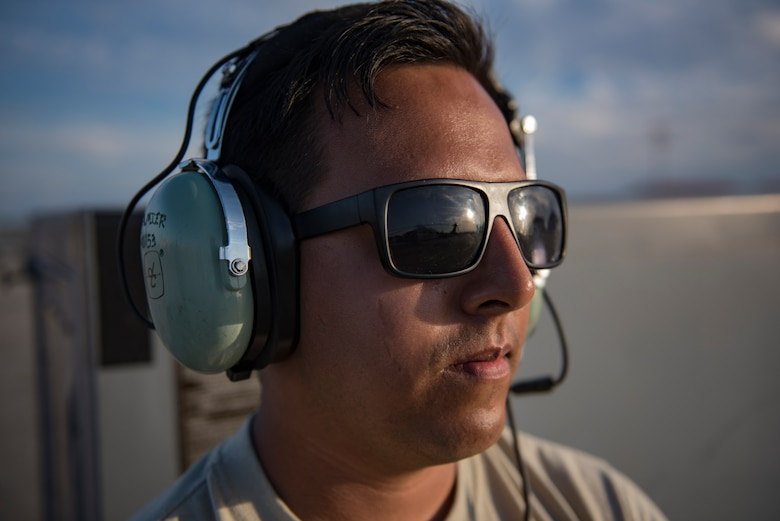 Senior Airman Aaron Mier, 41st Helicopter Maintenance Unit crew chief, watches as an HH-60G Pave Hawk prepares to launch, Dec. 12, 2016, at Patrick Air Force Base, Fla. Airmen conducted two weeks of spin-up training with a higher operations tempo to provide a more realistic deployed environment. (U.S. Air Force photo by Airman 1st Class Daniel Snider)