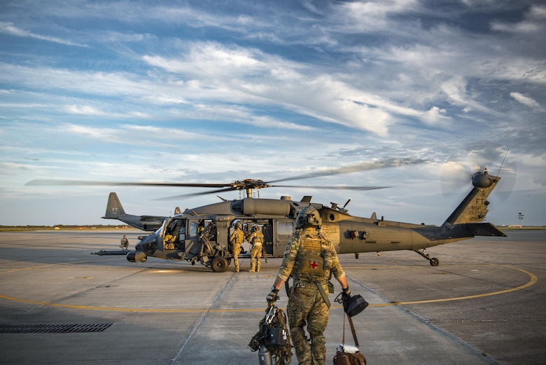 A special missions aviator from the 41st Rescue Squadron walks towards an HH-60G Pave Hawk for an engine-running crew swap during a pre-deployment 'spin-up' exercise, Dec. 12, 2016, at Patrick Air Force Base, Fla. During the spin-up, the 41st RQS, alongside mission partners from the 38th and 71st Rescue Squadrons, conducted high-tempo rescue operations designed to mimic the missions they will fly downrange. They based their operations out of Patrick AFB and flew missions to Avon Park Air Force Range, Fla. (U.S. Air Force photo by Staff Sgt. Ryan Callaghan)