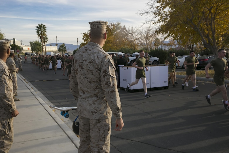 Brig. Gen. William F. Mullen III, Combat Center Commanding General, watches the students and staff of the Marine Corps Communication-Electronics School drop off donated toys during the Toys for Tots Fun Run aboard Marine Corps Air Ground Combat Center, Twentynine Palms, Calif., Dec. 14, 2016. (Official Marine Corps photo by Lance Cpl. Dave Flores/Released)