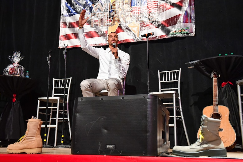 Utah Jazz point guard George Hill speaks during the G3 Holiday Bash 2016, Park City Film Studios, Park City, Utah, Dec. 15, 2016. The focus of the event was to assist Utah military families during the holiday season. The event also featured live and silent auctions to raise money for the local military community, and a concert by country singer Dustin Lynch. (U.S. Air Force photo/R. Nial Bradshaw)