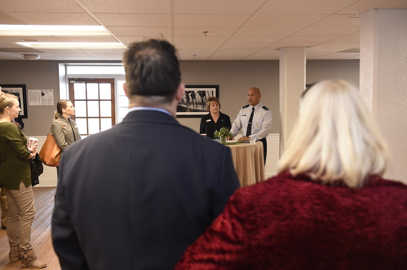 U.S. Air Force Col. Jimmy Canlas, 437th Airlift Wing commander and Federal Executive Association (FEA) military co-chair, middle, welcomes attendees to the Federal Executive Association of the Greater Charleston Area Holiday Coffee Drop-in at Coast Guard Sector Charleston's Brass Buckle conference room Dec. 16, 2016. More than 90 representatives from federal agencies in the Charleston area attended the Holiday Coffee Drop-in. The Federal Executive Association promotes coordination of federal agency programs for maximum public benefit and to foster stronger relationships between the agencies' management officials. Canlas is the military co-chair of the FEA in addition to his role as wing commander.