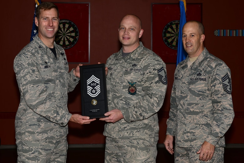 U.S. Air Force Col. David Mineau, the 354th Fighter Wing commander, and Chief Master Sgt. Brent Sheehan, the 354th FW command chief, present Senior Master Sgt. Joey Meininger, the 354th Civil Engineer Squadron deputy fire chief, with his newest stripe and line number for his selection to the highest enlisted rank of chief master sergeant Dec. 9, 2016, at Eielson Air Force Base, Alaska. Meininger was informed on Dec. 7 that he made it to the top one percent of the enlisted force. This photo was edited for propriety. (U.S. Air Force photo by Airman Eric M. Fisher)