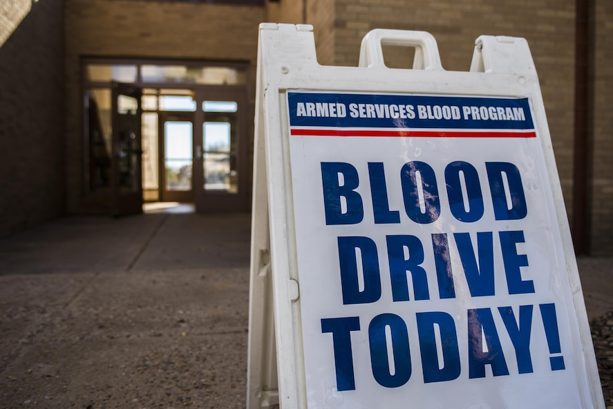 A sign promoting an Armed Services Blood Program blood drive sits outside of bldg. 54 on Nov. 16, 2016, Cannon AFB, N.M. The ASBP hosts a blood drive at Cannon approximately once every two months and facilitates more than 50 donors each visit. (U.S. Air Force photo by Senior Airman Luke Kitterman/Released)