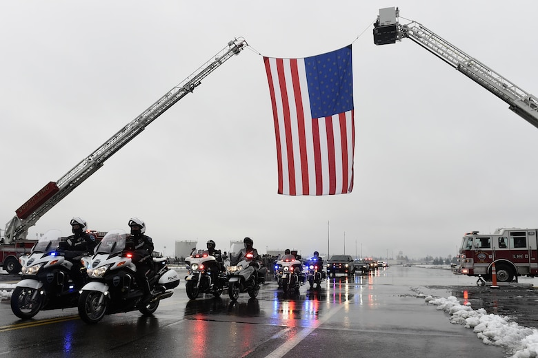"The funeral procession for Tacoma Police Officer Reginald ""Jake"" Gutierrez leaves Joint Base Lewis-McChord, Wash., Dec. 9, 2016, on their way to the funeral location at the Tacoma Dome in Tacoma, Wash. JBLM was chosen as the staging area because of its ability to accommodate the more than 450 vehicles and its proximity to the funeral location created the least amount of impact to the surrounding traffic patterns. (U.S. Air Force photo/Tech. Sgt. Tim Chacon)"