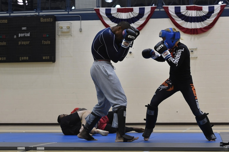Tech. Sgt. Franklin Mosley, 633rd Security Forces flight chief and combatives course instructor, braces for a punch during a sparring session with Valentina Shevchenko, an Ultimate Fighting Championship Muay Thai specialist, at Joint Base Langley-Eustis, Va., Dec. 9, 2016. Shevchenko visited JBLE as part of a morale tour and used her free time between events to train for an upcoming match. Although she is new to the UFC with a record of 2-1, she has a professional kickboxing record in Kyrgyzstan of 58-2. (U.S. Air Force photo by Staff Sgt. Nick Wilson)