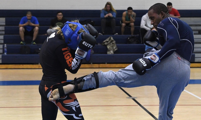 "Tech. Sgt. Franklin Mosley, 633rd Security Forces flight chief and combatives course instructor, kicks Valentina Shevchenko, an Ultimate Fighting Championship Muay Thai specialist, during a training session at Joint Base Langley-Eustis, Va., Dec. 9, 2016. Shevchenko visited JBLE as part of a morale tour and used her free time between events to train for an upcoming match. She is also a professional kickboxer from Kyrgyzstan, who began her professional career when she was 12 years old, when she knocked out a 22-year-old opponent, earning the nickname ""Bullet."" (U.S. Air Force photo by Staff Sgt. Nick Wilson)"