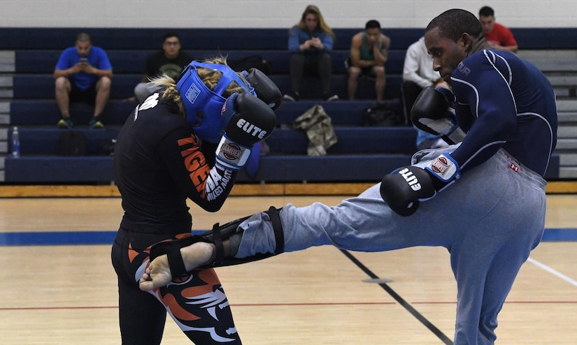 """Tech. Sgt. Franklin Mosley, 633rd Security Forces flight chief and combatives course instructor, kicks Valentina Shevchenko, an Ultimate Fighting Championship Muay Thai specialist, during a training session at Joint Base Langley-Eustis, Va., Dec. 9, 2016. Shevchenko visited JBLE as part of a morale tour and used her free time between events to train for an upcoming match. She is also a professional kickboxer from Kyrgyzstan, who began her professional career when she was 12 years old, when she knocked out a 22-year-old opponent, earning the nickname """"Bullet."""" (U.S. Air Force photo by Staff Sgt. Nick Wilson)"""