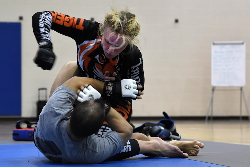 """Valentina Shevchenko, Ultimate Fighting Championship mixed martial artist, spars with U.S. Army Sgt. Dale Addy, 128th Aviation Brigade at Joint Base Langley-Eustis, Va., Dec. 9, 2016. Shevchenko not only trained with service members, but also visited U.S. Army and U.S. Air Force units throughout the week as part of a military appreciation visit. She is also a professional kickboxer from Kyrgyzstan, who began her professional career when she was 12 years old, when she knocked out a 22-year-old opponent, earning the nickname """"Bullet."""" (U.S. Air Force photo by Staff Sgt. Nick Wilson)"""