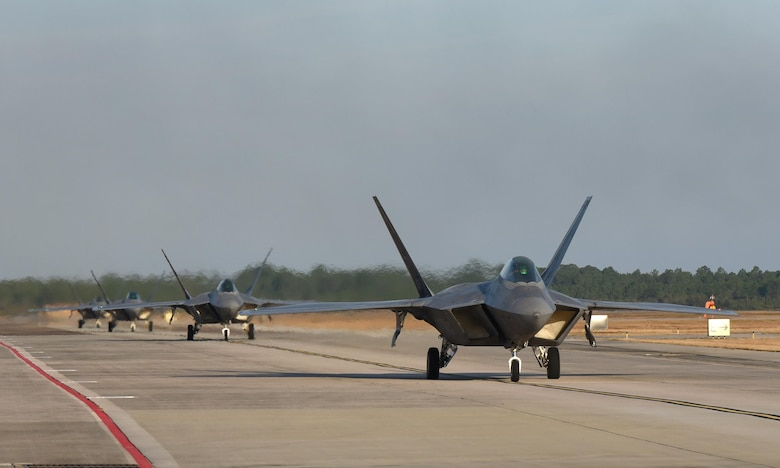 Four U.S. Air Force F-22 Raptors from Tyndall Air Force Base, Fla., taxi down Tyndall's flightline during Checkered Flag 17-1, Dec. 8, 2016. During the exercise, Tyndall's F-22s were joined by F-35 Lightning IIs, F-15E Strike Eagles, F-16 Fighting Falcons, HH-60G Pave Hawks and an E-3 Sentry to ensure seamless integration in a simulated deployed location. (U.S. Air Force photo by Staff Sgt. Alex Fox Echols III/Released)