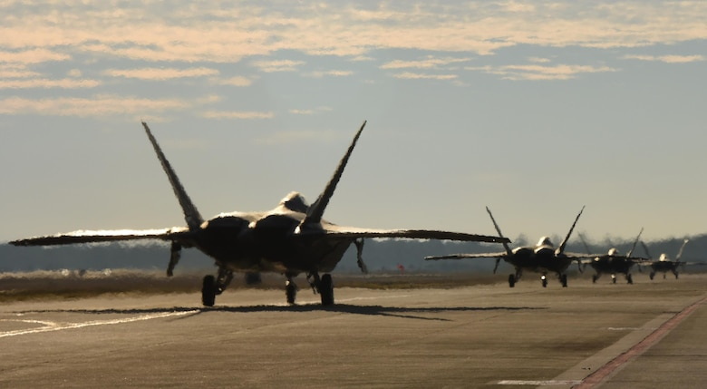 Four U.S. Air Force F-22 Raptors from Tyndall Air Force Base, Fla., taxi down Tyndall's flightline during Checkered Flag 17-1, Dec. 8, 2016. During the exercise, the units involved are evaluated on their ability to mobilize, integrate, deploy and employ combat air power assets on a large scale. (U.S. Air Force photo by Staff Sergeant Alex Fox Echols III/Released)